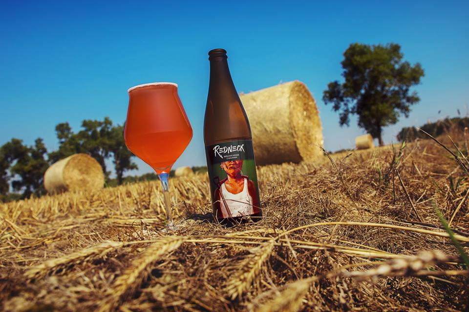 Redneck illustration on beer bottle in fields landscape photo by Takie Krafty and Jakub Cichecki