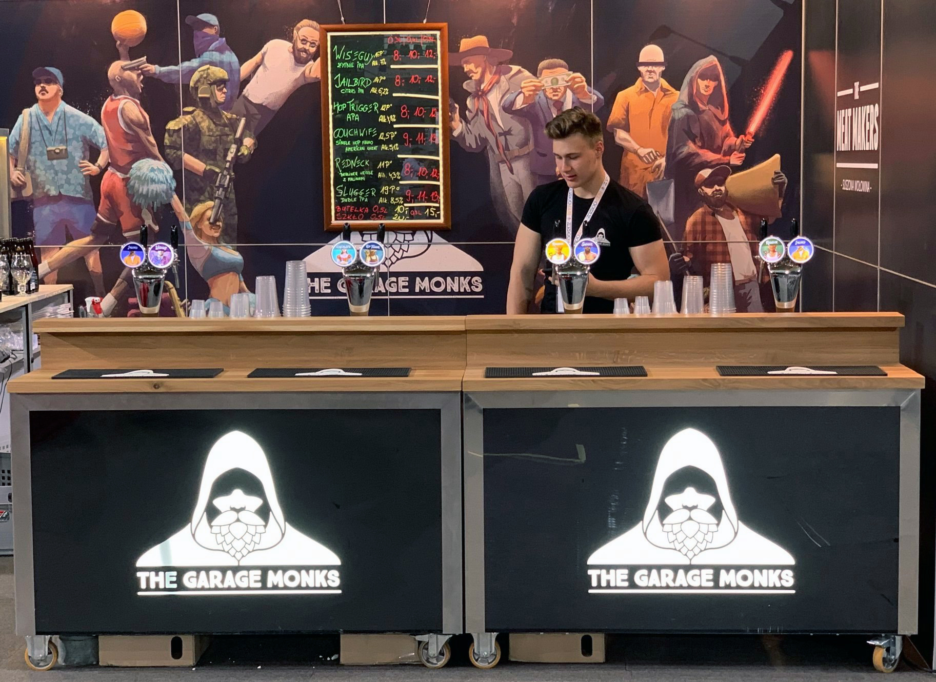 The Garage Monks bar photo showing logos and illustration on booth wall by Jakub Cichecki